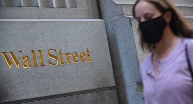 Wall Street leads global stocks slump as Covid-19 infections rise