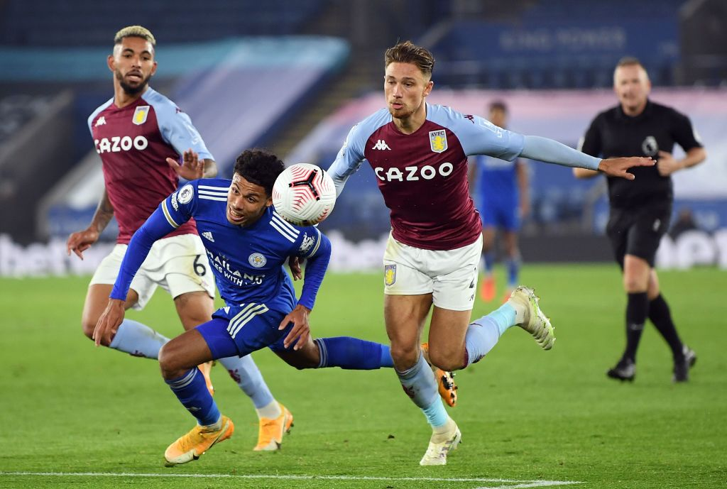 Leicester's James Justin challenges for the ball with Aston Villa's Matty Cash