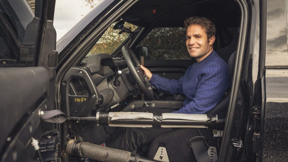 Tim Pitt driving 007 Land Rover Defender