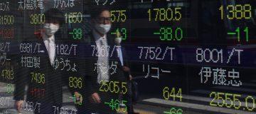 Asian stocks mixed as investors weigh 'virus vs. vaccine'