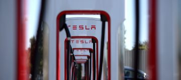 Tesla shares jumped 14 per cent yesterday after it was announced that the electric car maker would join the S
