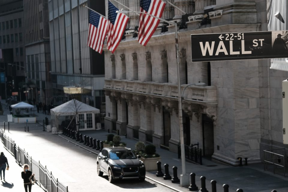 Wall Street edged back from record highs this evening after a surprise increase in jobless claims dimmed hopes of a swift economic recovery.