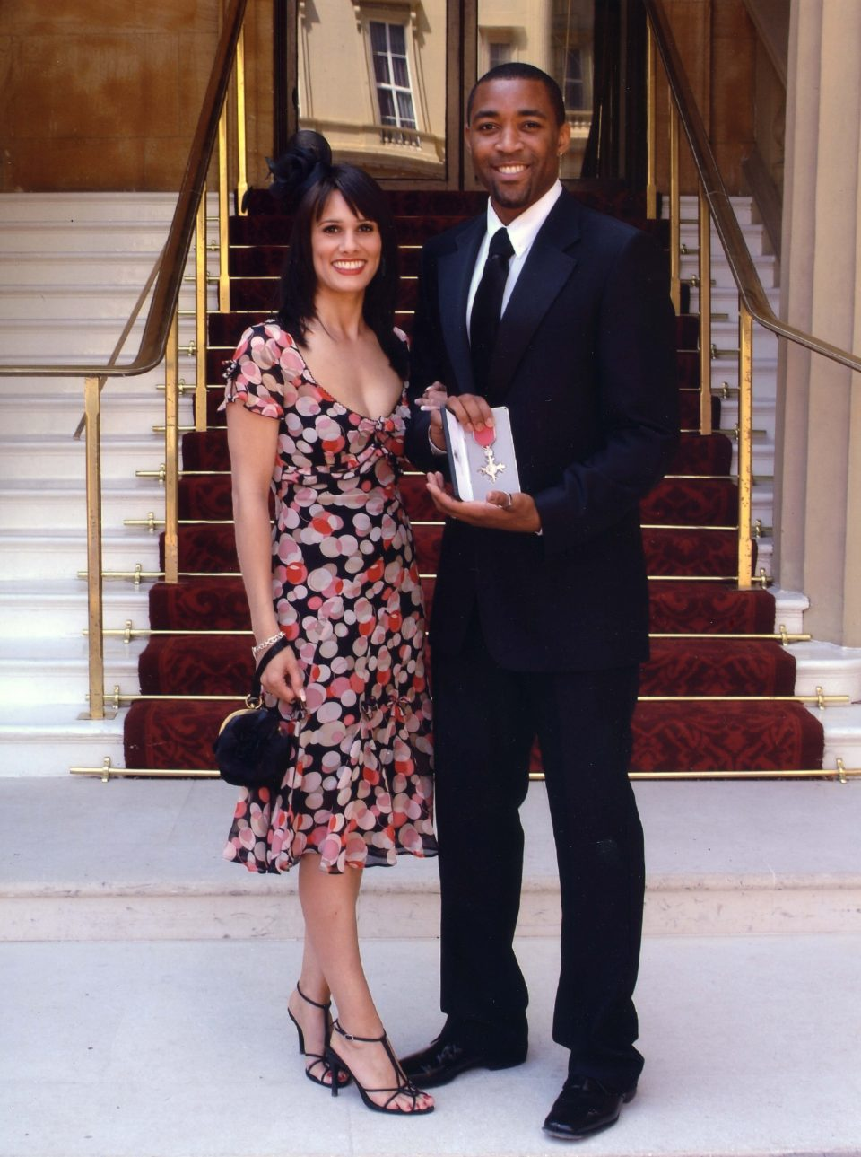Campbell, pictured above with wife Clair, received the MBE in 2005 for his part in Team GB's Olympic gold-winning men's 4 x 100m relay team the previous summer
