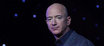 Amazon founder Jeff Bezos will join the winner of a competition on Blue Origin's first human spaceflight, with 20 July the target launchdate.