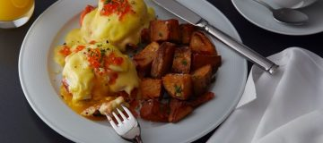 Breakfast: Smoked salmon eggs benedict with herb-roasted potatoes at the Loews Regency Hotel