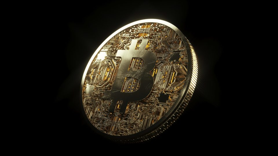 Bitcoin large on dark background - Image by SnapLaunch from Pixabay