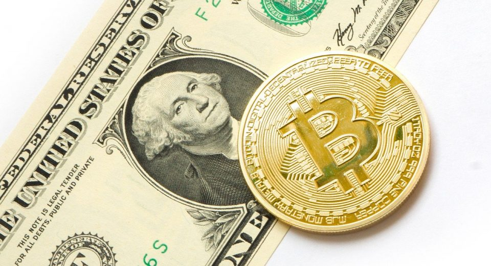 Bitcoin on a dollar bill - Image by Tom Bark from Pixabay