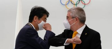 The IOC vaccine offer, announced by president Thomas Bach (right), may ease concerns in Japan about the planned influx of visitors for this summer's Tokyo 2020 Olympics