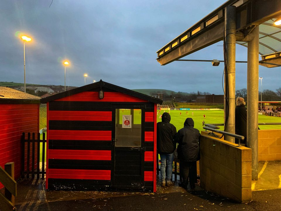 Beach huts take the place of hospitality boxes at the Dripping Pan, the distinctive home ground of Lewes FC