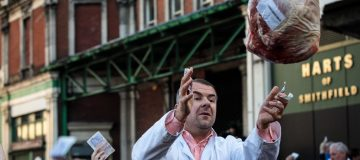 Annual Christmas Eve Meat Sell-off Takes Place At Smithfield Market