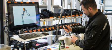 Chancellor Merkel Visits KUKA Robotics Factory