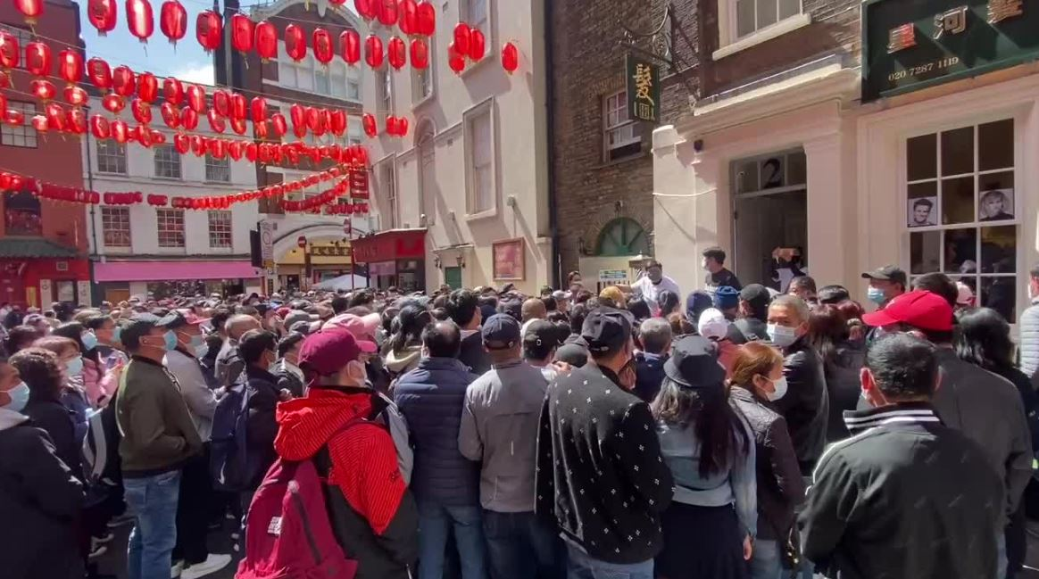 Crowds flood London's Chinatown for no-questions-asked Covid vaccines