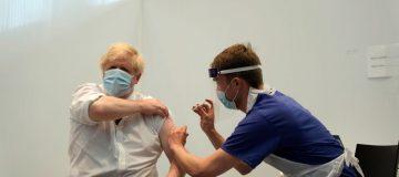 British PM Boris Johnson Visits Vaccination Centre In London