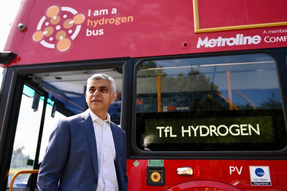 Mayor of London Sadiq Khan stands besides new hydrogen bus