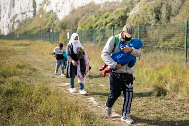 Migrants With Children Arrive On Kent Beach After Crossing Channel