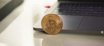 Bitcoin near laptop