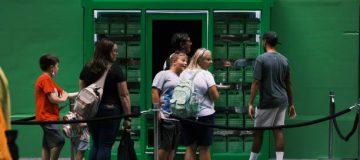 People queue up to purchase Robinhood merchandise