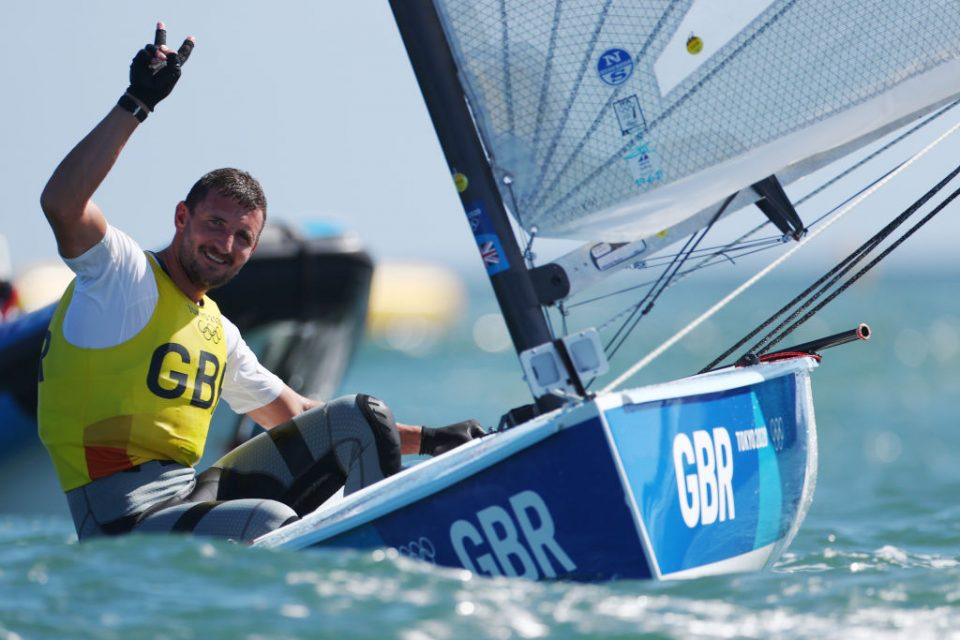 Giles Scott defended his Finn title as Team GB celebrated two gold medals in sailing at the Tokyo 2020 Olympics this morning